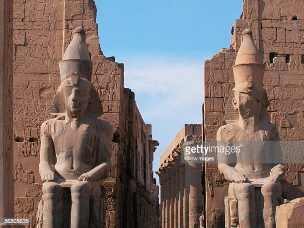 Close-up of two statues in a temple, Temple Of Luxor, Luxor, Egypt
