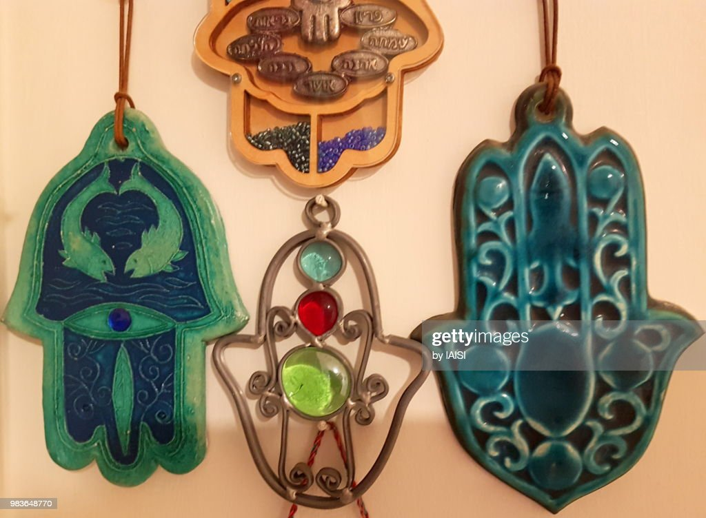 Close-up of two turquoise-colored hamsas for house protection from the evil eye : Stock Photo
