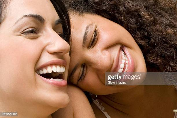 Close-up of two university students laughing