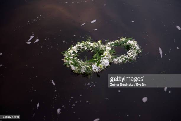 Close-Up Of Two Wreaths In The River