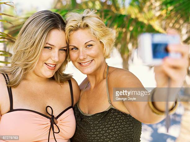 close-up of two young overweight women taking a picture of themselves - short hair for fat women stock pictures, royalty-free photos & images