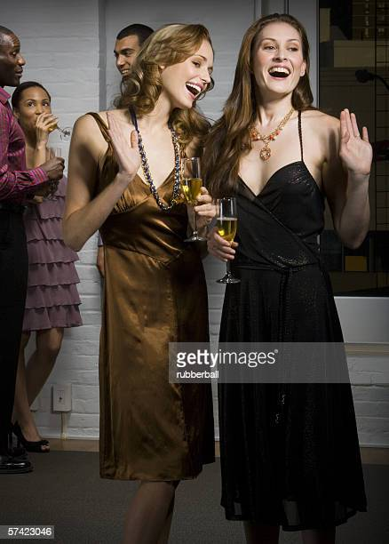 Close-up of two young women smiling at a party