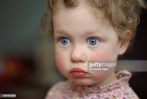 close-up of two-year-old girl face - ピンクの頬 ストックフォトと画像