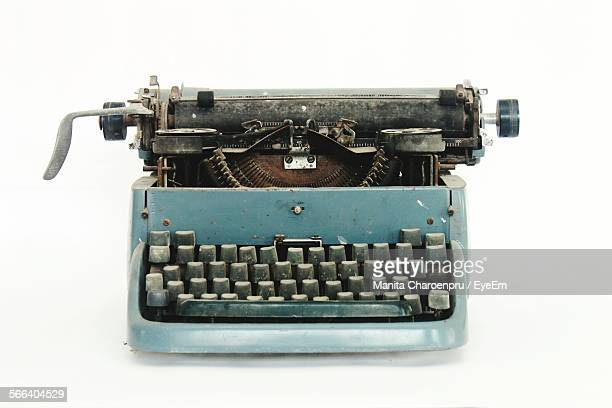 Close-Up Of Typewriter Against White Background