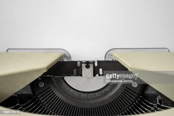 close-up of typewriter with paper - literatur stock-fotos und bilder