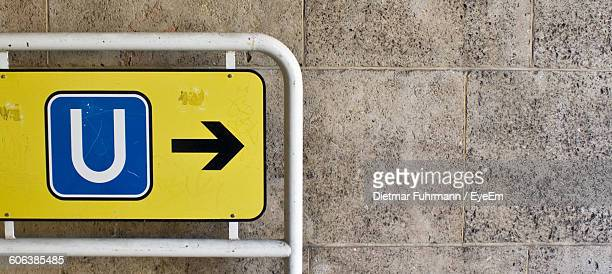 close-up of underground sign against wall - letter u stock photos and pictures
