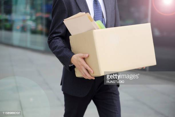 close-up of unemployed businessperson carrying cardboard box - being fired photos stock pictures, royalty-free photos & images