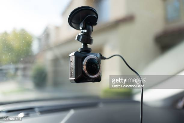Closeup of Uniden dashboard camera installed on the interior window of an Uber vehicle in San Ramon California dashcams are often used by...