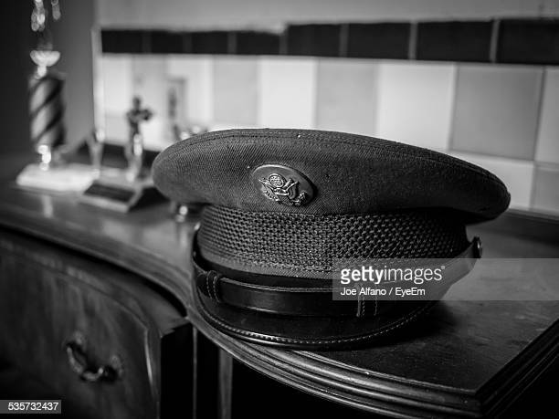 close-up of uniform cap on table - uniform cap stock pictures, royalty-free photos & images