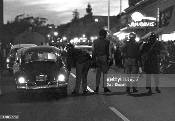 Closeup of uniformed officers as they stand on Telegraph Avenue to block demonstrators who attempt to march towards People's Park Berkeley California...