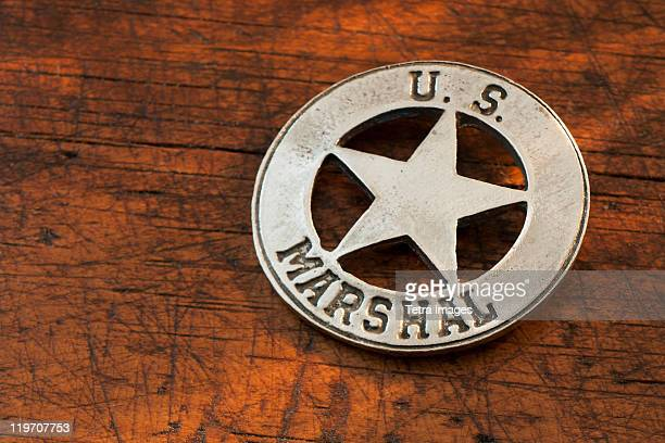 Close-up of United States Marshal badge