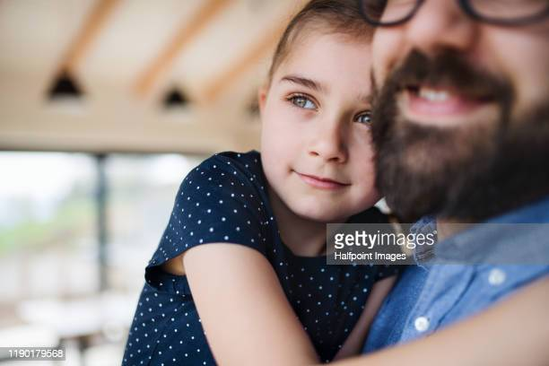 closeup of unrecognizable father and his small daughter indoors at home, hugging. - mid section stock pictures, royalty-free photos & images