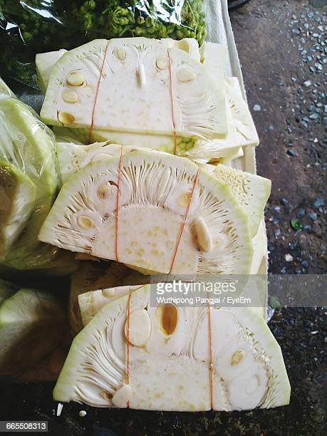 close-up of unripe jackfruit slices at market - unripe stock photos and pictures