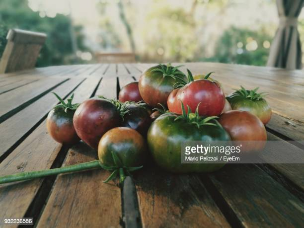 Close-Up Of Unripe Tomatoes On Table