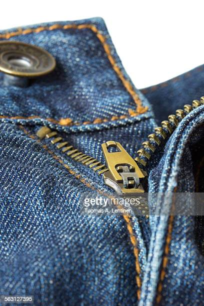 Close-up of unzipped and unbuttoned blue jeans