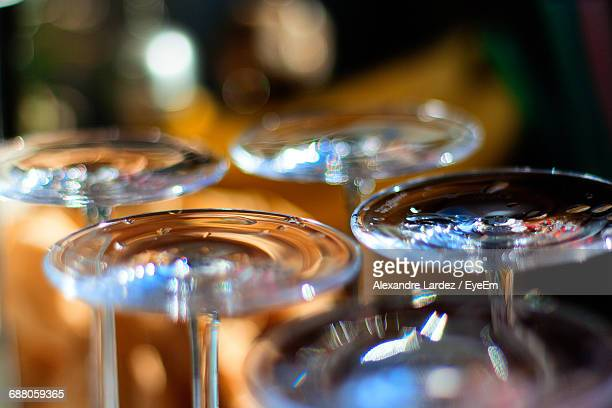 Close-Up Of Upside Down Wineglasses