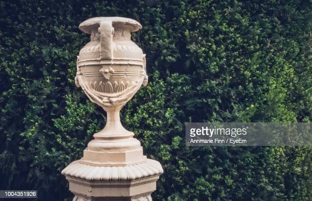 Close-Up Of Urn Against Plants At Park