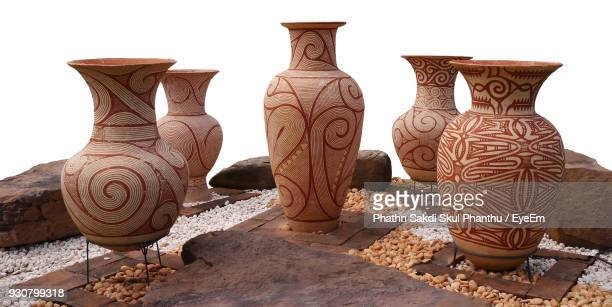 close-up of urns against white background - vaso de barro imagens e fotografias de stock