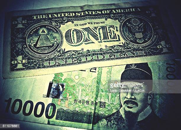 close-up of us currency with korean currency - korean currency stock photos and pictures