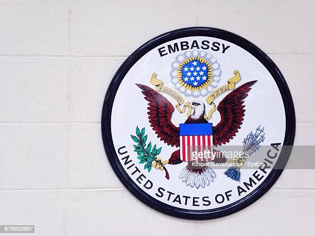 close-up of us embassy sign on white wall - us embassy stock pictures, royalty-free photos & images