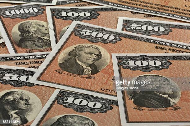 close-up of us patriot bonds certificates of various values - stock certificate stock pictures, royalty-free photos & images