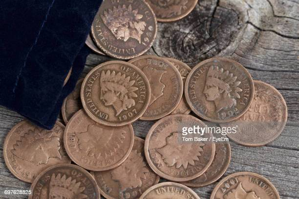 Close-Up Of Us Pennies On Wooden Table
