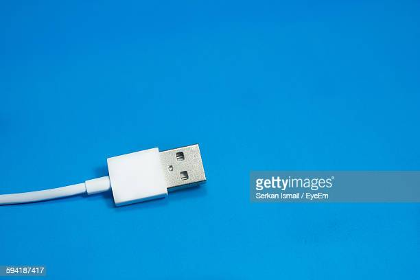 Close-Up Of Usb Cable Over Blue Background