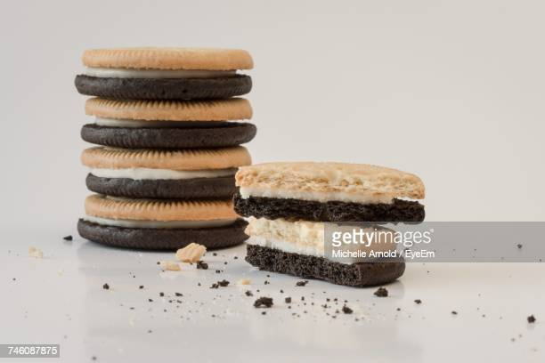 Close-Up Of Vanilla And Chocolate Cookies On White Background