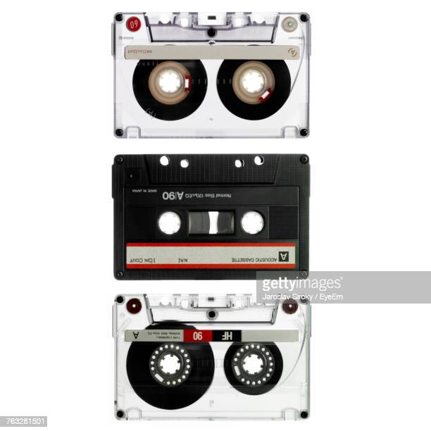 Close-Up Of Various Audio Cassettes Against White Background