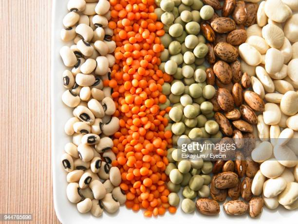 close-up of various beans in plate on table - legume family stock pictures, royalty-free photos & images