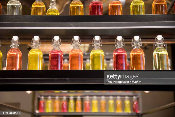 close-up of various bottles on shelf at store - hoogeveen stock pictures, royalty-free photos & images