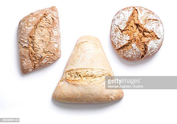 Close-Up Of Various Bread Against White Background