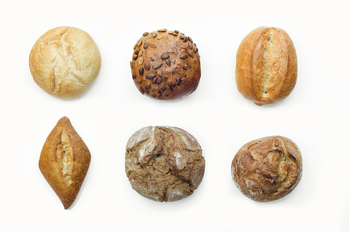 Close-Up Of Various Breads Against White Background - gettyimageskorea