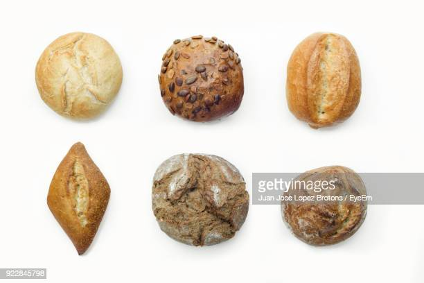 Close-Up Of Various Breads Against White Background