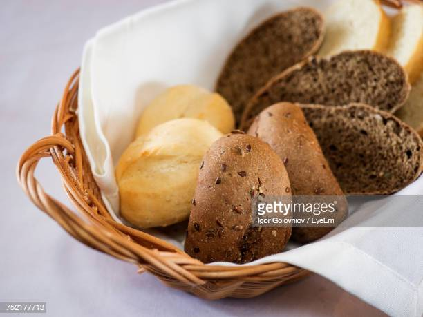 close-up of various breads in wicker basket on table - igor golovniov stock pictures, royalty-free photos & images