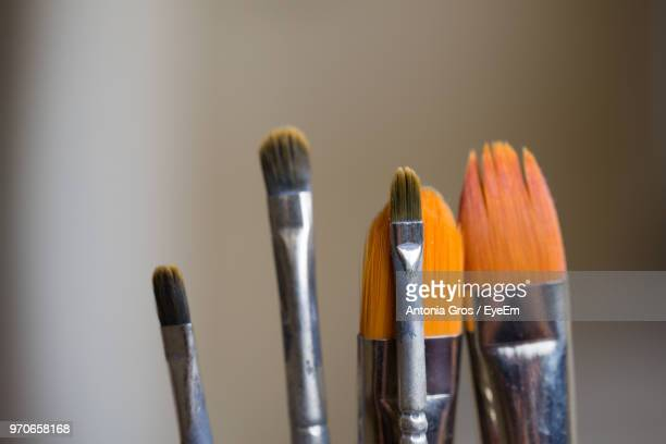Close-Up Of Various Brush Against Colored Background