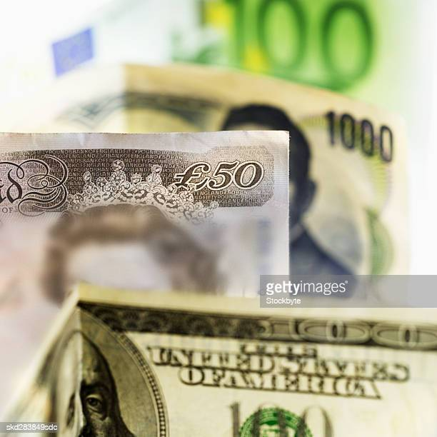 close-up of various currency bank notes - fifty pound note stock photos and pictures