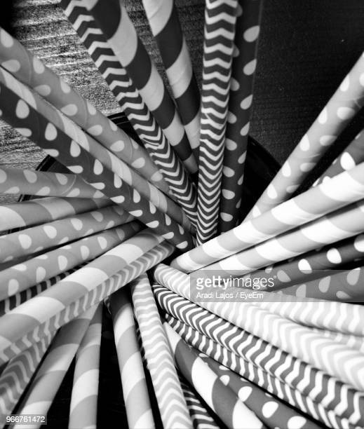 Close-Up Of Various Drinking Straws In Container