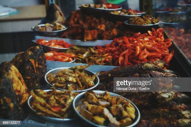 close-up of various food for sale - guwahati stock photos and pictures