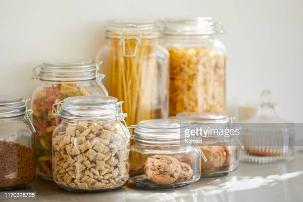 close-up of various food in airtight jars - storage compartment stock pictures, royalty-free photos & images