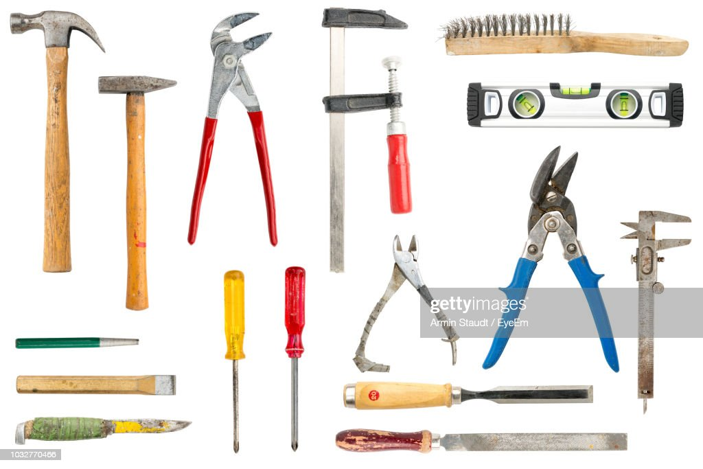 Close-Up Of Various Hand Tools Against White Background : Stock Photo