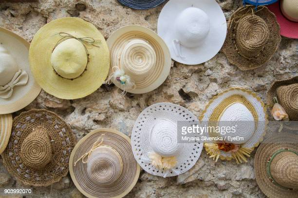 Close-Up Of Various Hats On Wall At Market