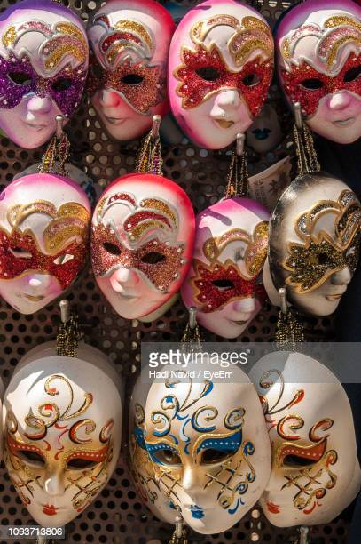 Close-Up Of Various Masks For Sale In Market
