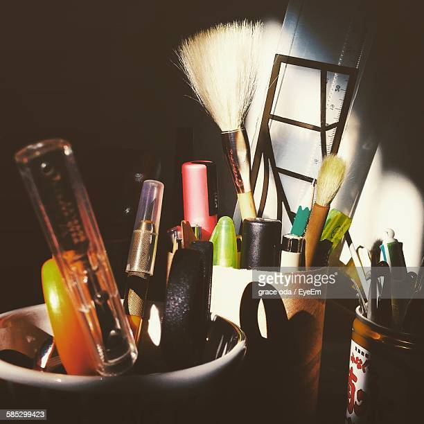 Close-Up Of Various Objects In Desk Organizers