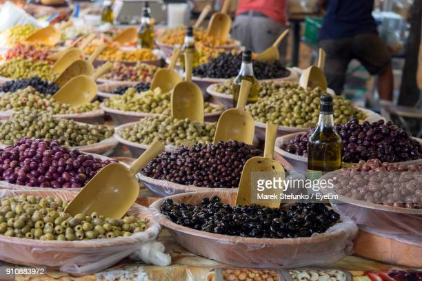 close-up of various olives for sale at market stall - marek stefunko stock pictures, royalty-free photos & images