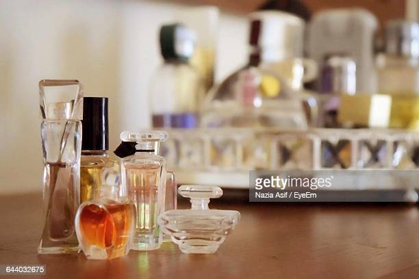 Close-Up Of Various Perfume Bottles On Table