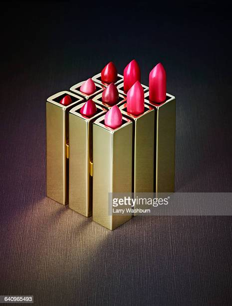 close-up of various pink lipsticks on table - still life foto e immagini stock