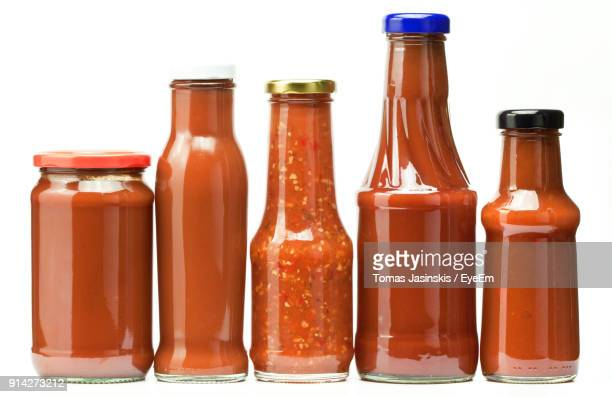 close-up of various sauce in bottles against white background - sauce stock pictures, royalty-free photos & images