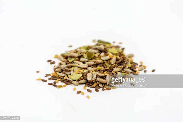 close-up of various seeds over white background - sesame stock pictures, royalty-free photos & images