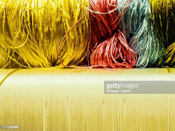 Close-Up Of Various Silk Threads On Loom In Carpet Factory